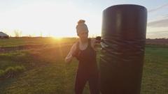 Tough girl on punching bag 4k Stock Footage