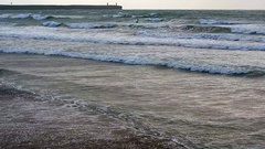 Windsurfer on beach, Tramor beach, County of Waterford, Republic of Ireland Stock Footage