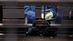 Worker at automate machine on Industrial factory Stock Footage