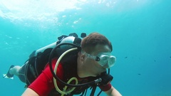 Novice diver learns to swim with scuba diving Stock Footage