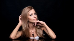 Beauty female video. Blonde woman model posing at mirror table Stock Footage