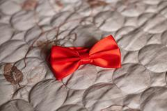 Red wedding bow tie on gray background Stock Photos