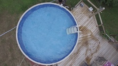 Aerial guy flips into swimming pool 4k Stock Footage