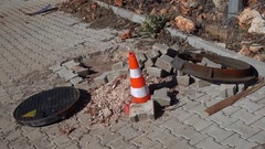 Changing manhole covers and a pylon on the road Stock Footage