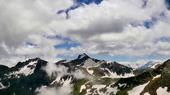 High Snowy Tops of Mountains with Clouds Timelapse. Kavkaz region Stock Footage