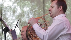 The man playing the trumpet in the orchestra Stock Footage
