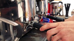 Man dust a dish drainer on coffee machine - close up hands Stock Footage
