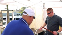 A cook sells a submarine sandwich to a customer Stock Footage