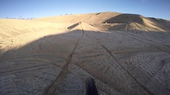 Dirt bike sand hip jump helmet cam motocross Stock Footage