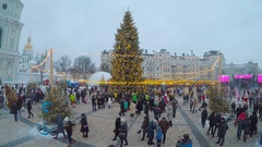 People visit the Market and enjoy the central Christmas Tree in Kiev. Stock Footage