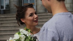 Young pretty women with a bouquet smiling to her man after meeting Stock Footage