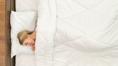 The young woman sleeping on the bad. Time lapse Stock Footage