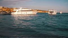 Sea Cruise Yacht Swim to the Dock Port in the Red Sea on Sunset Stock Footage