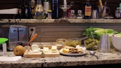 Kitchen fingers foods on counter panning shot Stock Footage