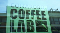 Coffee Costadoro Lab logo behind a window Stock Footage