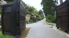 Gate and path in Japanese Garden Stock Footage