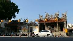 Da Guan Yin Ting temple at busy street Stock Footage