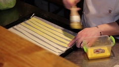 Lubrication sticks of dough on a baking tray Stock Footage