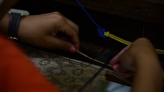 Picking - raising the heddles which raise the warp yarns Stock Footage