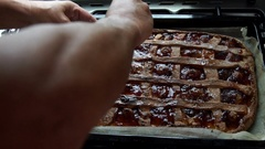Cook puts sugar on a tart before being baked. Slow motion. Stock Footage
