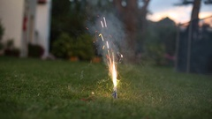 Lighting a firework in a suburbian backyard  Home firework during new year Stock Footage