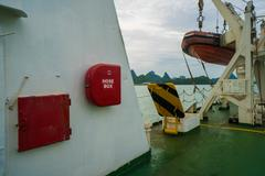 Fire hose cabinet and rescue motor-boat in the ferry ready for action Stock Photos