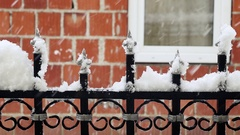 Close up of metal decorative fence in the snow Stock Footage