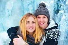 Happy loving couple walking in snowy winter forest, Outdoor seasonal activities Stock Photos