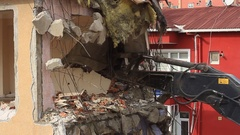 Excavator bucket used to tear down an old house. Demolition of a building Stock Footage