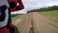 Dirtbike slow motion helmet cam extreme jumping Stock Footage