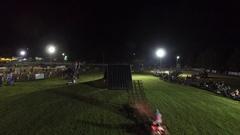 Aerial atv quad freestyle superman seatgrab night show 4k Stock Footage