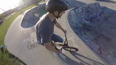 Bmx go pro spinner barspin to manual at skatepark Stock Footage