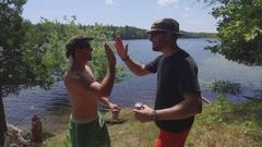 Camping buddies high five and chug beer bromance 4k Stock Footage