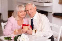 Happy senior couple celebrating anniversary Stock Photos