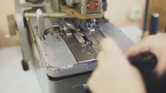 Clothes sewing on the sewing machine Stock Footage
