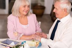 Lovely senior lady gazing at her gentleman with love Stock Photos