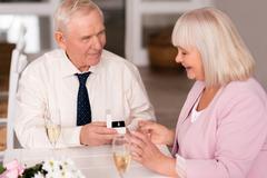 Handsome elderly man making a proposal Stock Photos