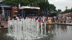 US Open Tennis fans walk past fountains outside Arthur Ashe Stadium Stock Footage