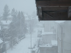 Snowstorm in the village under the eaves of a house in slow motion Stock Footage