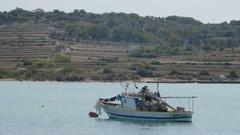 Malta, Valletta - July 3, 2016. Fishing boat anchorage Bay, Valletta Stock Footage
