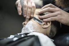 Funny shaving of little boy Stock Photos