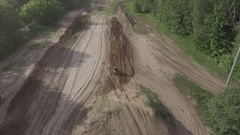 Aerial behind dirtbike jumping on motcross track Stock Footage