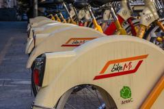 BikeMi Logo on A Rack of Bike Sharing Bicycles in Milan Italy during Winter.. Kuvituskuvat