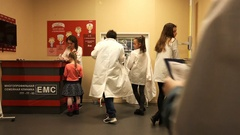 Children teenagers in white coats are training in a medical office in clinic Stock Footage