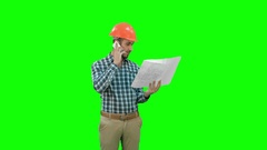 Site manager talking on the phone holding blueprints on a Green Screen, Chroma Stock Footage