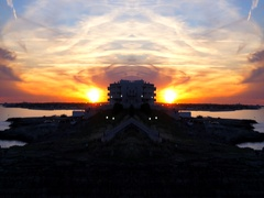 Abstract video with mirror effect. Beautiful sunset in Polignano a Mare, Italy Stock Footage
