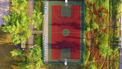 Flying over tenis court, basketball court and trainers Stock Footage
