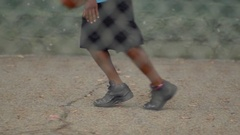 A young man basketball player practicing his ball handling, slow motion. Stock Footage