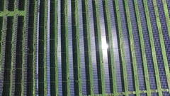 Aerial solar farm directly above closeup then zoom out 4k Stock Footage