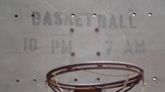 Basketball sign written on the backboard of basketball hoop, slow motion. Stock Footage